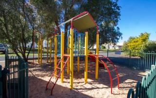 Fenced and shady children's playground
